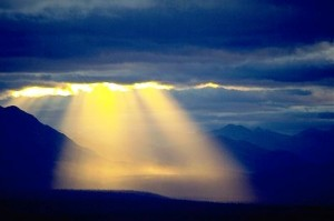Alaska. Denali Highway. Rays of warm evening light coming through clouds.